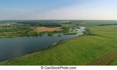 Flying Fast Over Fields and River - Aerial shot: Flying Over...