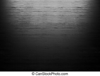 Black wood background with lighting from the window