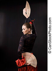 Flamenco - Attractive spanish dancer over black background