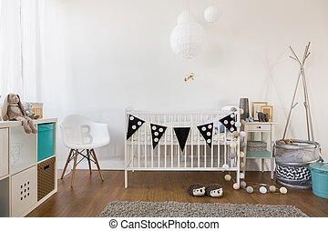 Cozy baby room decor - Horizontal view of cozy baby room...
