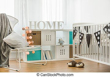 Crib and commode in cozy baby room