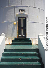 Slangkop Lighthouse - The green steps leading to the door of...