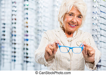 Smiling opticians patient - Image of smiling opticians...