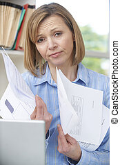 Woman Holding Bills Concerned About Debt