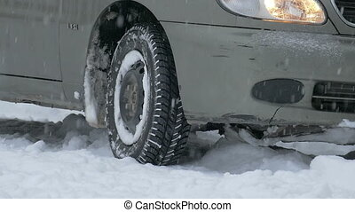 Tire on winter road - view of the wheel while driving on a...
