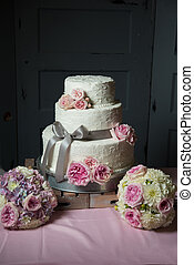 Wedding Cake sitting on wooden trays