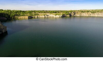Flying Over Quarry Lake - Aerial shot: Flying Over Quarry...