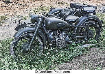 old army motorcycle with sidecar outside