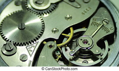 Clockwork close-up - The pendulum sways, the gears are...