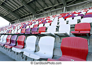 Multicolored chairs on the stadium