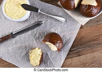 Pretzel Buns Butter Knife - HIgh angle view of a pretzel bun...
