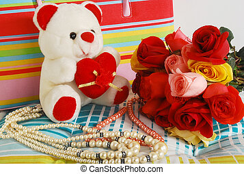 Love & romance - Beautiful teddy bear with roses and pearls.
