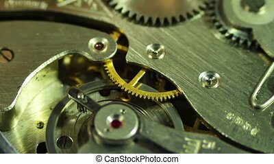 Clockwork close-up, Rotation - The pendulum sways, the gears...