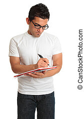 Man writing in a book notepad - A man writes in a spiral...