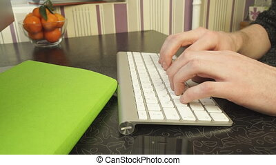 The man quickly typing on the keyboard. Easy to work with...