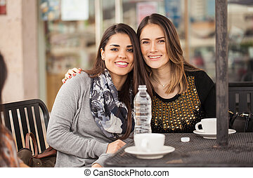Female friends hanging out at a cafe
