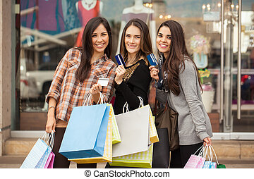 Spoiled women using their credit cards at a mall