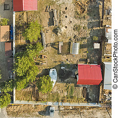 Aerial view on ground plot with cottage. Russia - Top view...