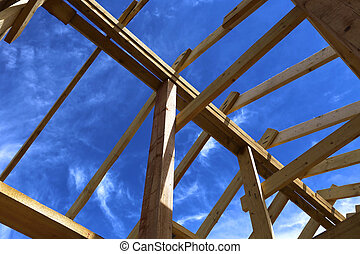 Installation of wooden beams at construction of the frame...