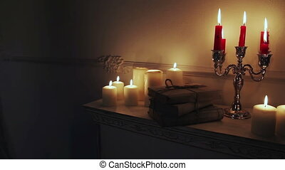 Old vintage books with candles in candlestick.
