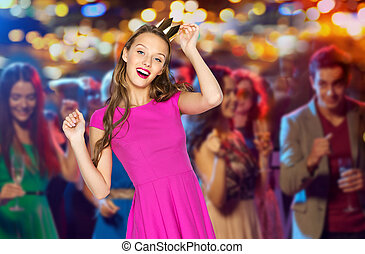 happy young woman in princess crown at night club - people,...