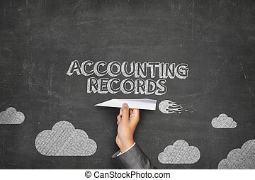 Accounting records concept on blackboard with paper plane -...