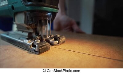 Machine cutting piece of wood veneer - A machine cutting the...
