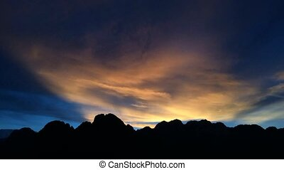Time lapse Beautiful sunset behind the mountains at Vang...