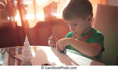 Little boy drawing with colored pencils 4 - Little boy...