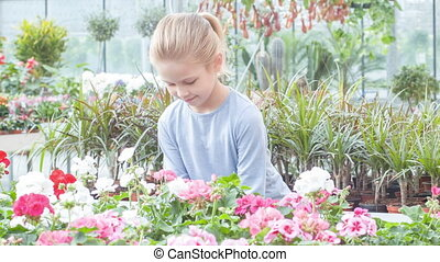 Little girl taking flower and inhaling the scent - Sniff up...