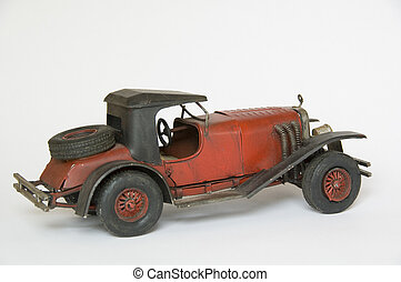Vintage toy car - Red and black vintage toy car on a white...