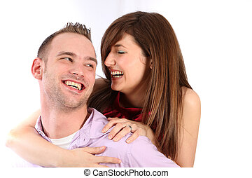 In love, young couple laughing together - space for text