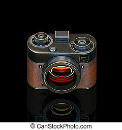Vintage photo camera with attrition on the shell on black...