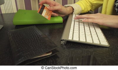 The girl makes a purchase online - Female hand holding a...