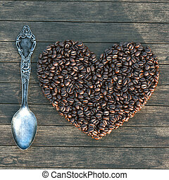 Vintage box with spoon and heart shape coffee beans on a...