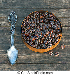 Vintage box with spoon and coffee beans on a wooden table 3D...