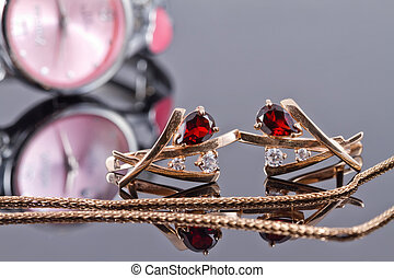 Gold earrings with rubies and elegant womens watches - Gold...