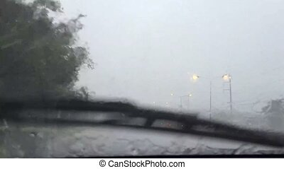 Driver Car in Rain with storm, obscures windshield, creates...