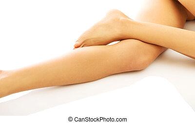 Womans naked crossed legs lying - Womans naked slim crossed...