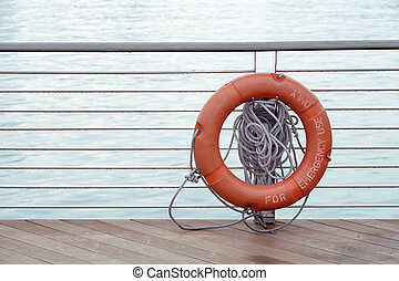 lifebuoy - red lifebuoy hanged on metallic handrails with...