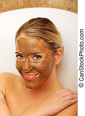Happy woman with chocolate mask - Happy spa woman with...