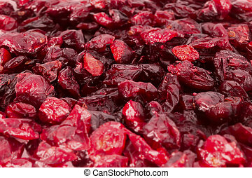 Low angle tilt-shift shot of dried cranberries in red