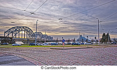 Railway bridge over Daugava river in Riga in Latvia at...