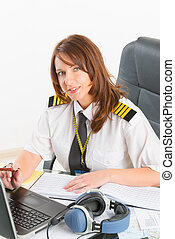 Woman airline pilot at the office - Beautiful woman pilot...