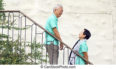 Asian senior couple travel for anniversary trip - Happy...
