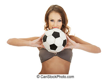 Woman in swimming bra with foot ball - Beautiful woman in...