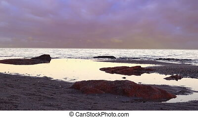 The Sea Shore at Sunset - The Sea Waves are Rolled on a...
