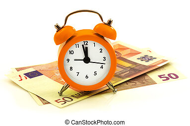Alarm clock with paper money, 50 euro isolated on white...
