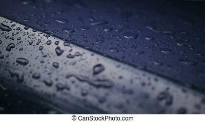 Waterdrops Falling On Hood of Car