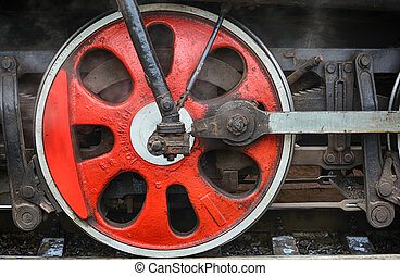 Train drive mechanism and red wheels of an old  steam locomotive